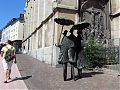 Even the statues were carrying parasols